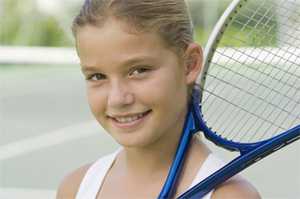 Closeup of a child with a Tennis racquet